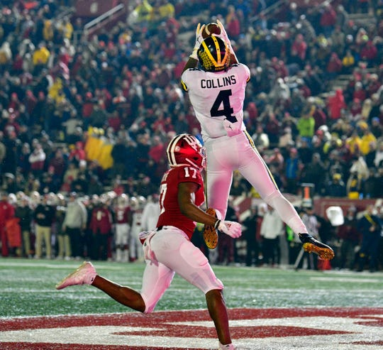 Michigan receiver Nico Collins catches a touchdown against Indiana defensive back Raheem Layne during the second half at Memorial Stadium, Nov. 23, 2019.