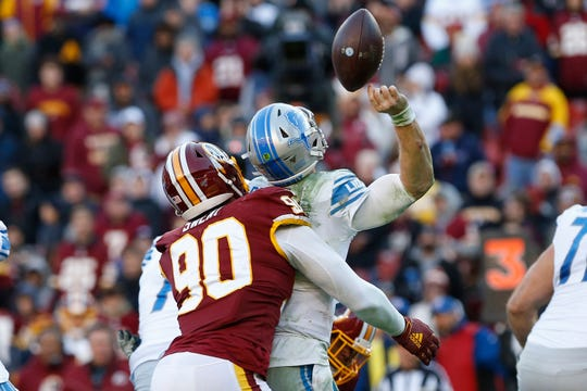Jeff Driskel fumbles while being hit by Washington's Montez Sweat in the third quarter at FedExField.