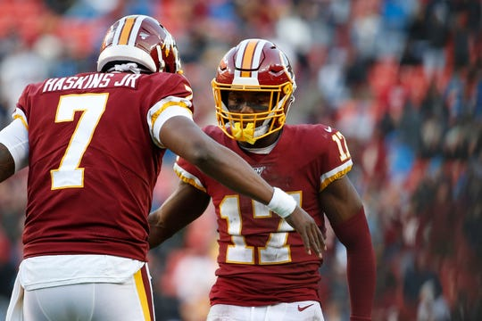 Washington Redskins receiver Terry McLaurin celebrates with Redskins quarterback Dwayne Haskins after a play against the Detroit Lions during the second half at FedExField, Nov. 24, 2019.