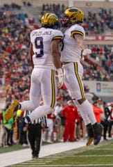 BLOOMINGTON, IN - NOVEMBER 23: Donovan Peoples-Jones #9 of the Michigan Wolverines and Ronnie Bell #8 of the Michigan Wolverines celebrate after a touchdown during the first half against the Indiana Hoosiers at Memorial Stadium on November 23, 2019 in Bloomington, Indiana. (Photo by Michael Hickey/Getty Images)
