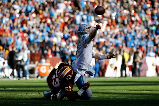 Lions quarterback Jeff Driskel, top, tries to throw a pass while being hit by Washington inside linebacker Jon Bostic during the first half on Sunday, Nov. 24, 2019, in Landover, Md.
