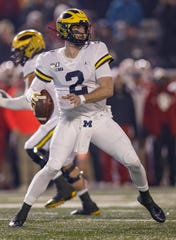 Michigan's Shea Patterson passes against Indiana on Nov. 23, 2019 in Bloomington, Ind.
