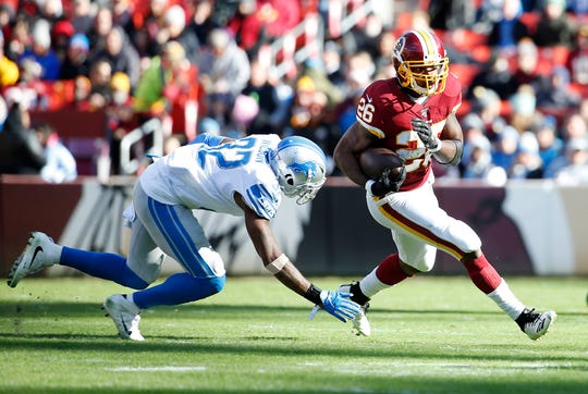 Washington running back Adrian Peterson carries the ball past Lions strong safety Tavon Wilson during the first quarter on Sunday, Nov. 24, 2019, in Landover, Md.