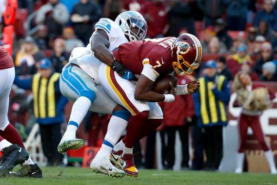 Washington quarterback Dwayne Haskins is sacked by Lions middle linebacker Jarrad Davis during the second half.