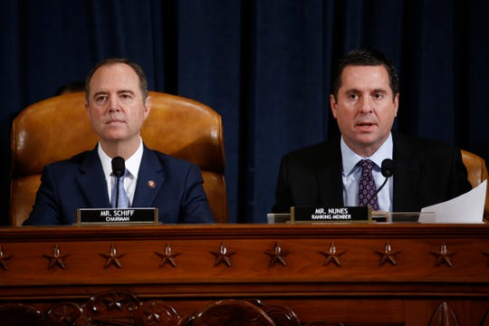 Rep. Devin Nunes, R-Calif., right, the ranking member of the House Intelligence Committee, and Chairman Adam Schiff, D-Calif.,