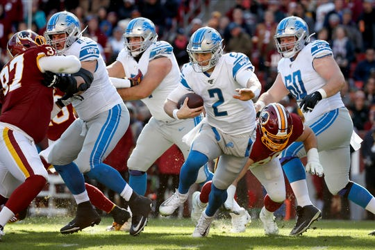 Detroit Lions quarterback Jeff Driskel scrambles against Washington on Sunday.