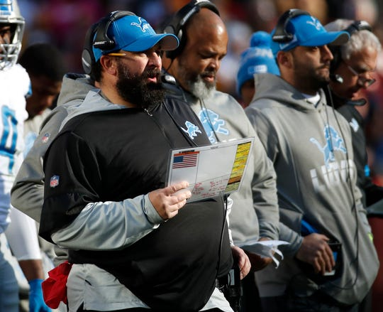 Detroit Lions head coach Matt Patricia, center left, looks on during the first half.