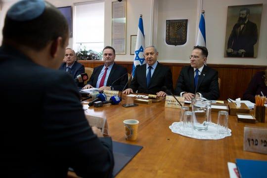 Israeli Prime Minister Benjamin Netanyahu heads the weekly cabinet meeting at the Prime Minister's office in Jerusalem, Sunday, Nov. 24, 2019. (AP Photo/Sebastian Scheiner, Pool)