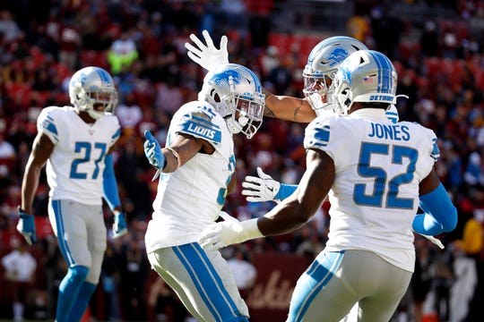 Detroit Lions safety Tavon Wilson, center, celebrates with teammates after recovering a fumble by Washington Redskins quarterback Dwayne Haskins.
