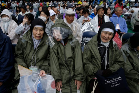 The faithful wait for Pope Francis at Nagasaki Prefectural Baseball Stadium, Sunday, Nov. 24, 2019, in Nagasaki, Japan.