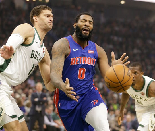 Andre Drummond (0) loses the ball against Milwaukee Bucks' Brook Lopez. Drummond finished with 12 points and 17 rebounds.