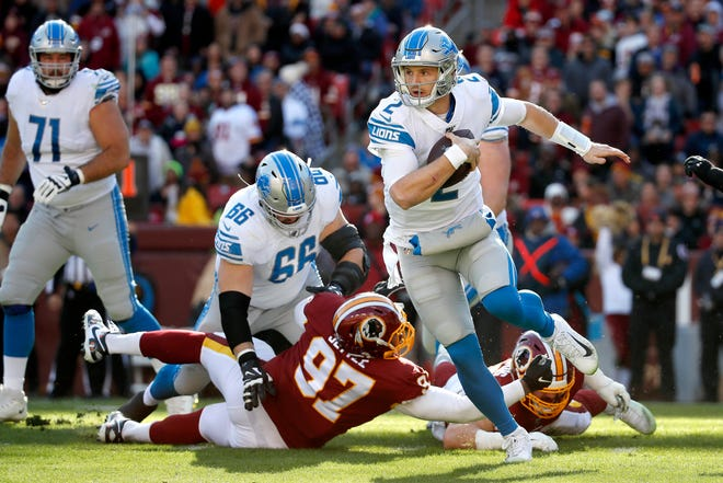 Detroit Lions quarterback Jeff Driskel  scrambles against the Washington Redskins during the first half.