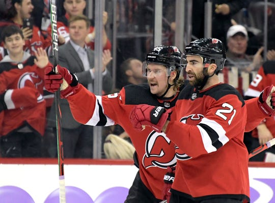New Jersey Devils center Kyle Palmieri (21) celebrates his goal with New Jersey Devils defenseman Sami Vatanen (45) during the second period.