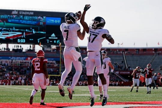 Michigan State wide receiver Cody White (7) celebrates after scoring a touchdown Saturday against Rutgers in Piscataway, New Jersey.
