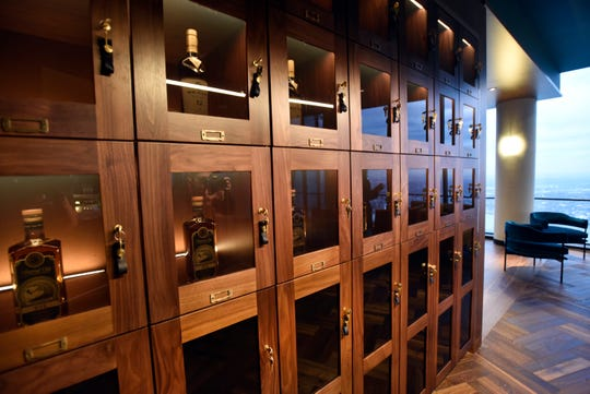 Storage lockers hold bottles that are part of the Whiskey Club, which is set up near the High Bar.