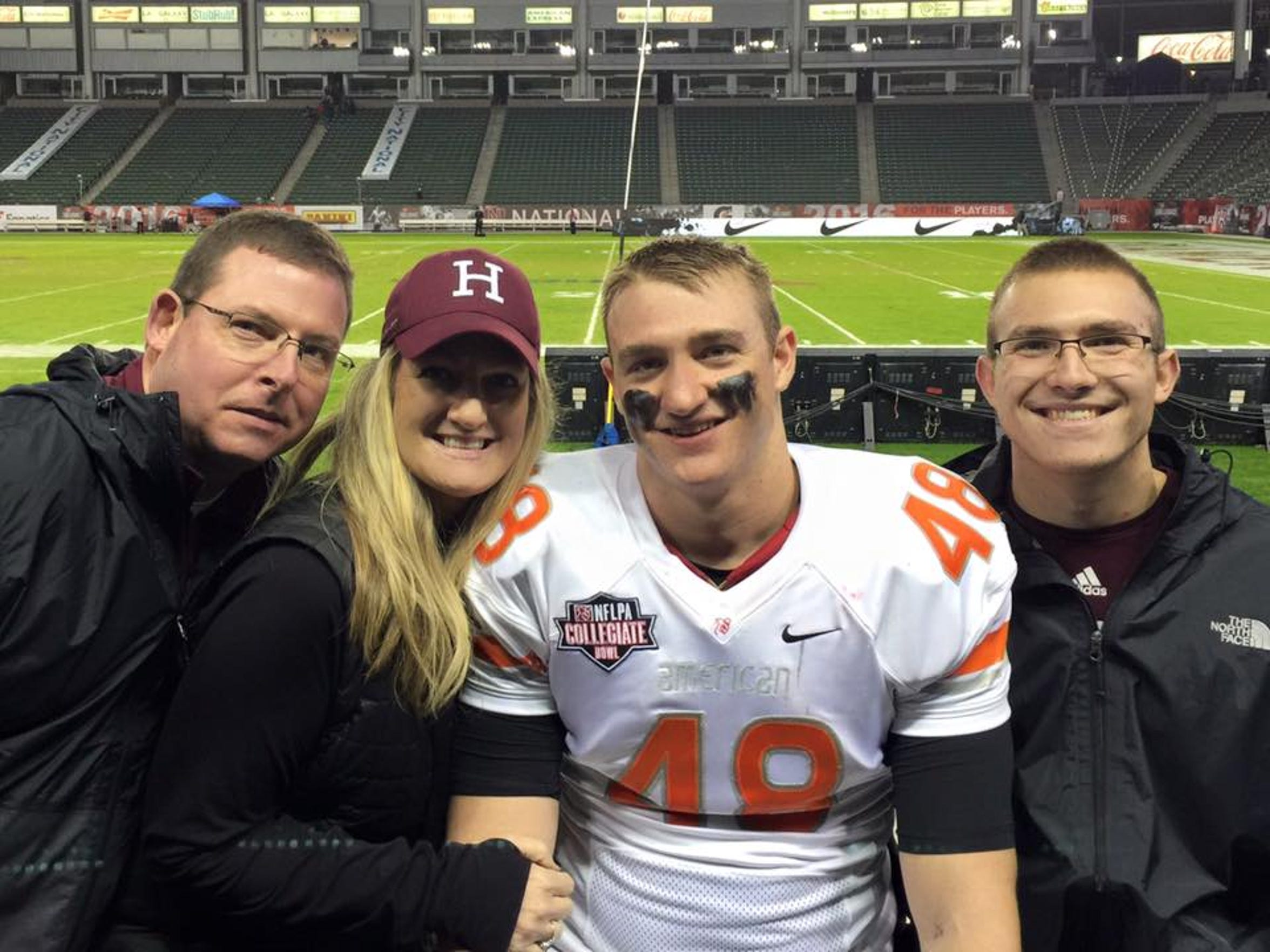 Ben's dad Brian, mom Kristen and brother Noah pose with Ben (center) following his performance in the NFLPA Collegiate Bowl.
