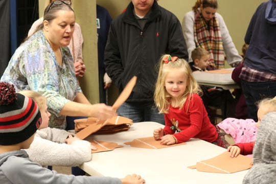 Ruby and Daisey Stines visited all the way from Columbus, enjoying the Winesburg Christmas Weekend with their parents. The Stines began Saturday morning with some gingerbread crafts at the Clyde Public Library.