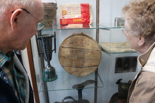Gerald and Anita Manzeck-Goldsby check out some of the items on display in the Harris-Elmore Public Library's new history exhibit room on Saturday.