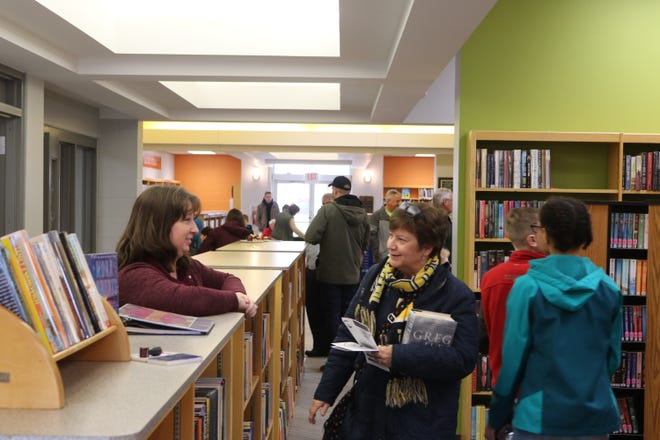 The Harris-Elmore Public Library debuted its brand new renovations and expansion with a grand reopening event on Saturday.