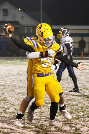 Clyde's Remington Norman celebrates after his fumble recovery late in the fourth quarter.