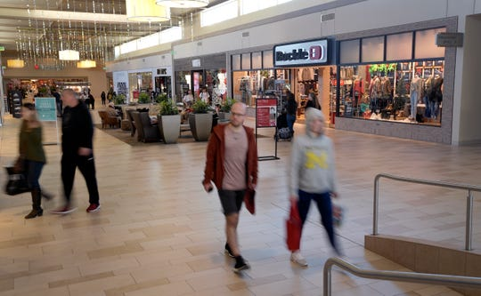 People walk through Foothills mall in Fort Collins, Colo. on Saturday, Nov. 23, 2019. The property is celebrating its fifth holiday season since the $313 million renovation.