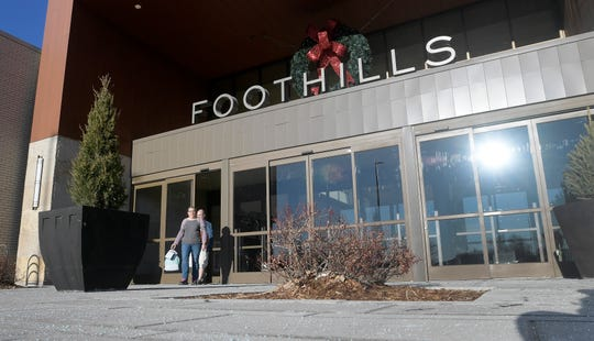 Patrons leave  Foothills mall in Fort Collins, Colo. on Saturday, Nov. 23, 2019.