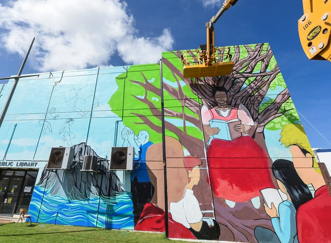 A mural project led by artist and John F. Kennedy High School art teacher, Francis Labrador, is commissioned in honor of the Guam Public Library System's upcoming 70th anniversary celebration at the Nieves M. Flores Memorial Library in Hagåtña, Nov. 24, 2019.