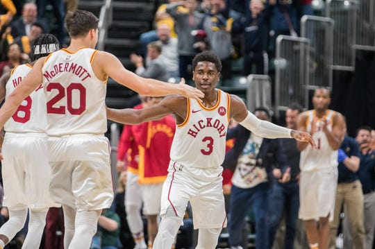 Nov 23, 2019; Indianapolis, IN, USA; Indiana Pacers guard Aaron Holiday (3) celebrates with team mates after shooting the game winning three point basket against the Orlando Magic in the second half at Bankers Life Fieldhouse.