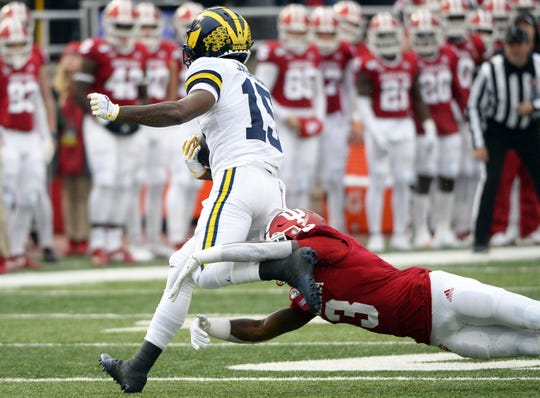 Indiana Hoosiers defensive back Tiawan Mullen (3) tackles Michigan Wolverines wide receiver Giles Jackson (15) during the game against Michigan at Memorial Stadium in Bloomington, Ind., on Saturday, Nov. 23, 2019.