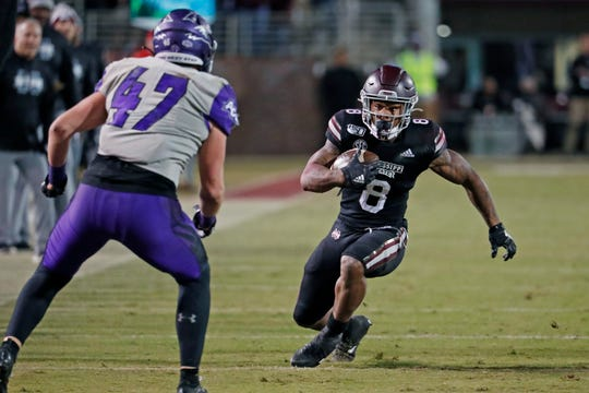 Mississippi State running back Kylin Hill (8) attempts to fake out Abilene Christian linebacker Jack Gibbens (47) during the second half of an NCAA college football game, Saturday, Nov. 23, 2019, in Starkville, Miss. Mississippi State won 45-7.