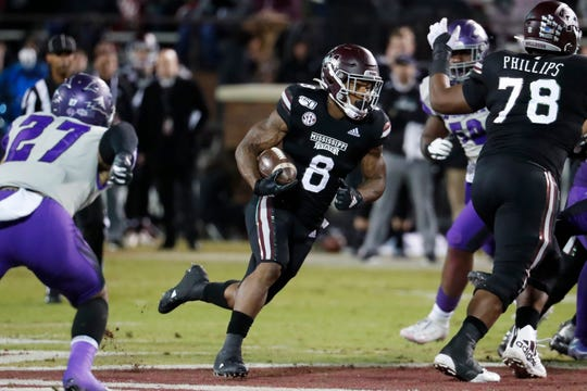 Mississippi State running back Kylin Hill (8) runs for a first down against Abilene Christian during the first half of an NCAA college football game, Saturday, Nov. 23, 2019, in Starkville, Miss.