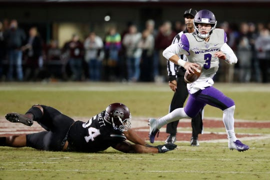 Abilene Christian quarterback Luke Anthony (3) evades a tackle by Mississippi State defensive tackle Fabien Lovett (54) during the second half of an NCAA college football game, Saturday, Nov. 23, 2019, in Starkville, Miss. Mississippi State won 45-7.