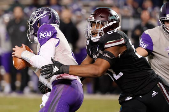 Mississippi State defensive end Kobe Jones (52) pressures Abilene Christian quarterback Luke Anthony (3) during the second half of an NCAA college football game, Saturday, Nov. 23, 2019, in Starkville, Miss. Mississippi State won 45-7.