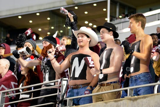 Nov 23, 2019; Starkville, MS, USA; Mississippi State Bulldogs fans cheer before a game against the Abilene Christian Wildcats at Davis Wade Stadium. Mandatory Credit: Matt Bush-USA TODAY Sports