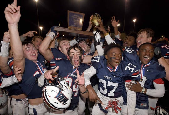 The Madison-Ridgeland Academy Patriots celebrate after winning the Class 6A MAIS state football championship on Saturday, Nov. 23, 2019, at Mississippi College.