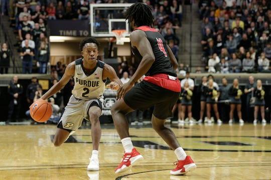 Purdue guard Eric Hunter Jr. (2) dribbles against Jacksonville State point guard Ty Hudson (4) during the first half of a NCAA men's basketball game, Saturday, Nov. 23, 2019 at Mackey Arena in West Lafayette.