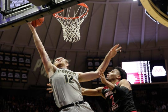Purdue forward Evan Boudreaux (12) goes up for a layup against Jacksonville State forward Jacara Cross (2) during the second half of a NCAA men's basketball game, Saturday, Nov. 23, 2019 at Mackey Arena in West Lafayette.