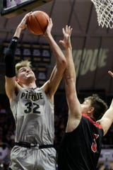 Purdue center Matt Haarms (32) goes up over Jacksonville State center Maros Zeliznak (3) for two during the second half of a NCAA men's basketball game, Saturday, Nov. 23, 2019 at Mackey Arena in West Lafayette.
