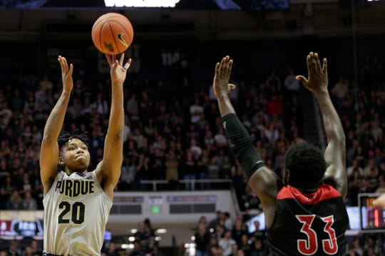 Purdue guard Nojel Eastern (20) goes up for two over Jacksonville State guard De'Torrion Ware (33) during the first half of a NCAA men's basketball game, Saturday, Nov. 23, 2019 at Mackey Arena in West Lafayette.