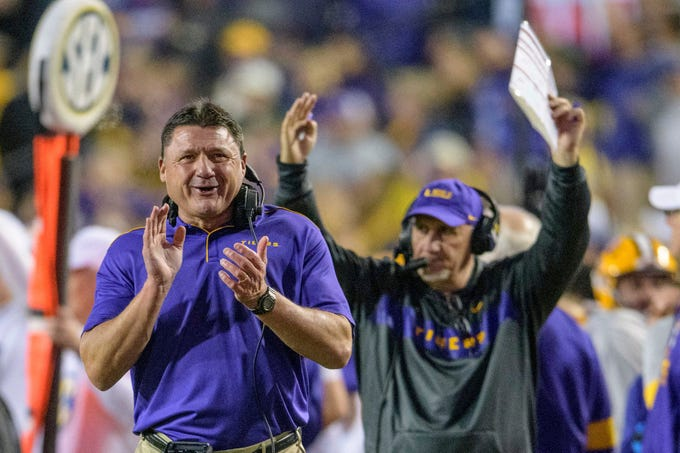 LSU head coach Ed Orgeron celebrates as LSU running back John Emery Jr. runs for a touchdown against Arkansas during the second half of an NCAA college football game in Baton Rouge, La., Saturday, Nov. 23, 2019. (AP Photo/Matthew Hinton)