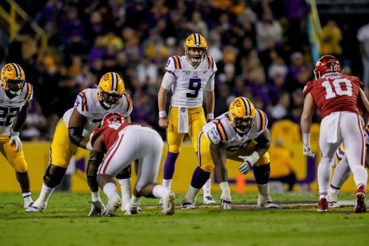 Nov 23, 2019; Baton Rouge, LA, USA;  LSU Tigers quarterback Joe Burrow (9) prepares for a play against the Arkansas Razorbacks during the first half at Tiger Stadium. Mandatory Credit: Stephen Lew-USA TODAY Sports