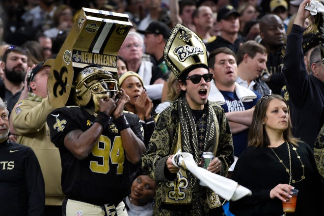 New Orleans Saints fans cheer the team, during the first half at an NFL football gam against the Carolina Panthers, Sunday, Nov. 24, 2019, in New Orleans(AP Photo/Bill Feig)