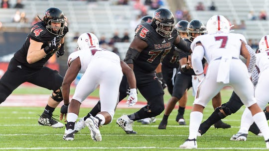 UL offensive guard Kevin Dotson (75) blocks during Saturday's 53-3 win over Troy at Cajun Field. Dotson has been picked to play in the East-West Shrine Bowl.