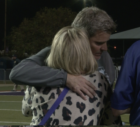 Demons Coach Brad Laird and his wife Renee embrace after the two-point conversion failed during the mid-season game.