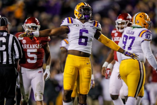Nov 23, 2019; Baton Rouge, LA, USA; LSU Tigers linebacker Jacob Phillips (6) reacts to a play against the Arkansas Razorbacks during the first half at Tiger Stadium. Mandatory Credit: Stephen Lew-USA TODAY Sports