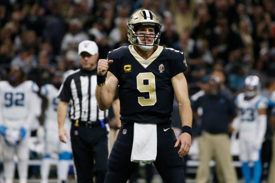 New Orleans Saints quarterback Drew Brees (9) gestures after a touchdown by wide receiver Michael Thomas (13), during the second half at an NFL football game against the Carolina Panthers, Sunday, Nov. 24, 2019, in New Orleans. (AP Photo/Butch Dill)