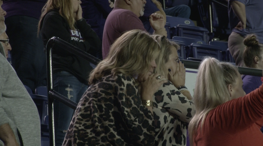 Renee Laird, the wife of Northwestern State's football coach, watches nervously as the Demons attempt a two-point conversion to try to win a game earlier this season.