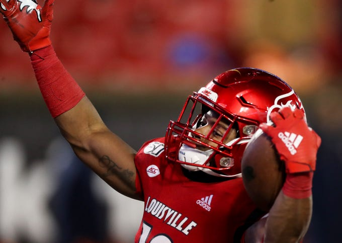 Louisville's Javian Hawkins celebrates after scoring a touchdown against Syracuse on Nov. 23, 2019