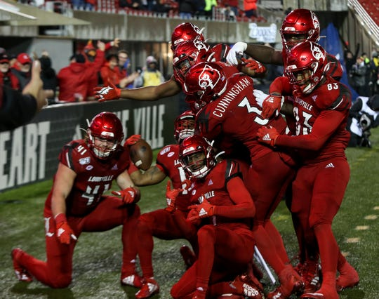 Louisville celebrates after Javian Hawkins scored a touchdown against Syracuse on Nov. 23, 2019.