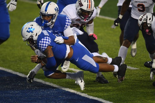 UK QB Lynn Bowden Jr. dives into the end zone for a touchdown during the University of Kentucky football game against UT Martin at Kroger Field in Lexington, Kentucky on Saturday, November 23, 2019.